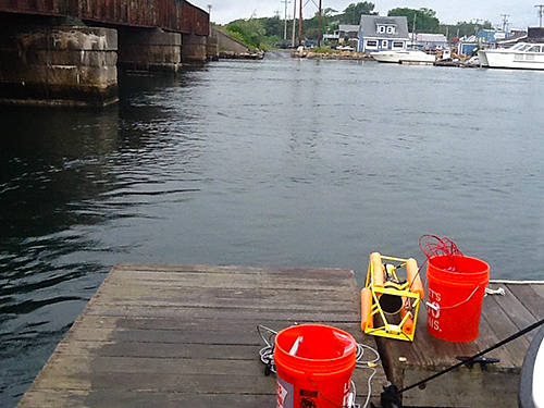 FSI's ACM being deployed from Eastwinds Lobster and Grill dock in Buzzards Bay, MA. Buckets contain computers and wifi devices for data transmission.
